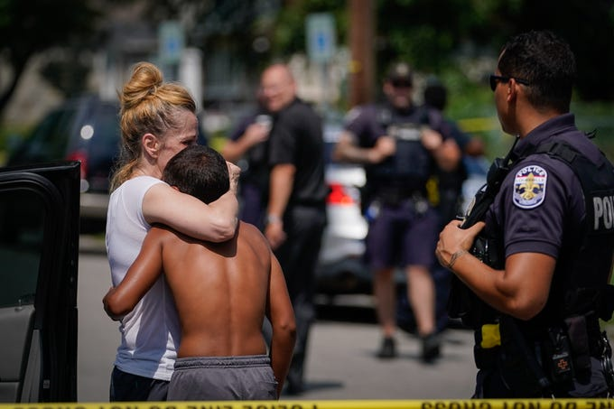 Louisville Metro Police investigate a shooting that resulted in the death of a 14 year old boy in the 3200 block of W Kentucky Street in Louisville, Ky., Friday, July 19, 2019.