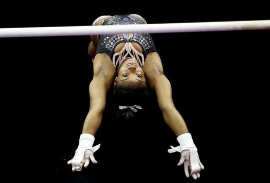 Simone Biles practices on uneven bars on July 19, 2019