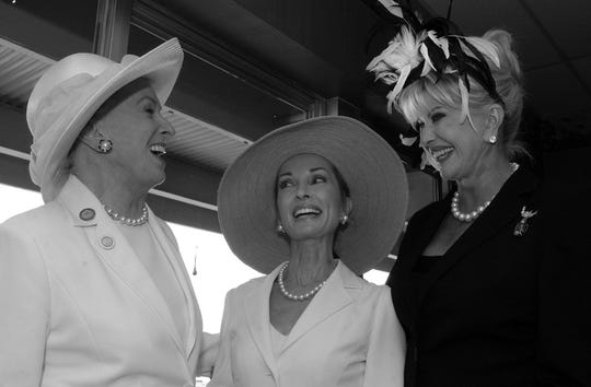 Mary Lou Whitney, whose horse Bird Town won the Kentucky Oaks in 2003, talked with her guests Susan Lucci, center, and Ivana Trump in the Stakes room.