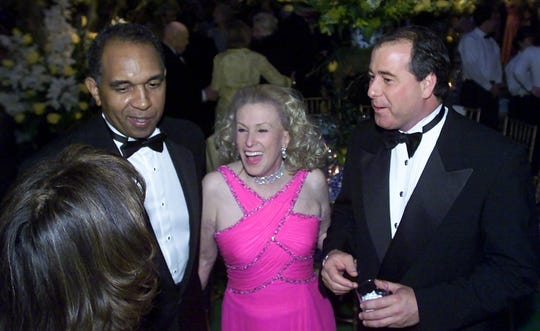 Coach Tubby Smith, Mary Lou Whitney and her husband, John Hendrickson, chatted with Smith's wife, Donna (back to camera), at the 2002 Lexington Ball.