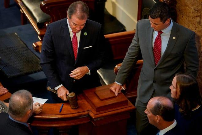 House Speaker David Osborne, left and Rep. David Meade, speaker pro tem, confer with other legislative leaders in 2019.