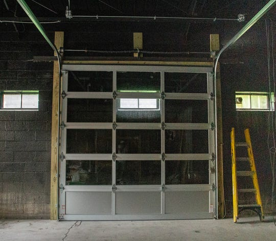 A garage door installed to open up to  the patio at Meat Southern B.B.Q. & Carnivore Copy Cuisine, part of an expansion to add another 1,300-square-feet of space to its footprint on Friday, July 19, 2019.