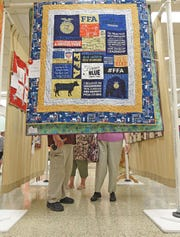 Visitors viewed and voted on their favorite quilts Friday at the Mansfield Millennium Quilt Guild's bi-annual quilt show at Malabar Middle School. The show featured more than 150 quilts and a quilting demonstration. For guild membership details, call 419-989-3460 or 419-631-4941.