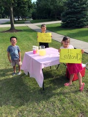 When you're 7, 5 and 4, running a lemonade stand is chock-full of lessons, from marketing to customer service to math.