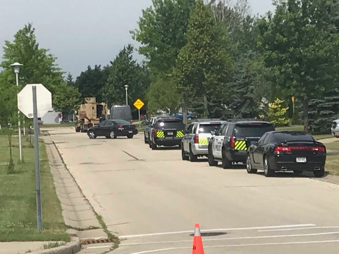 Multiple Oak Creek Police squads and tactical operations vehicles closed down East Sommers Drive at the South Shepard Avenue intersection the morning of July 19.
