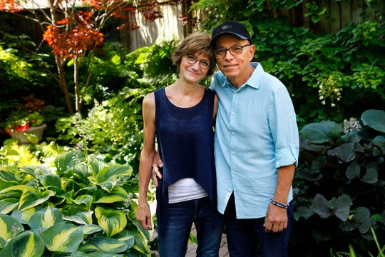 Janis and Toty Ramos pose in their garden, which will be featured on the Lakeside Garden Tour July 28.