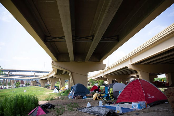 A tent village near 7th and Clybourn Streets, underneath the I-794 overpass, on Friday, July 19, 2019.