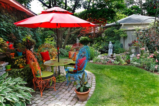 This novel table and chair set adds a vibrant splash of color to the Ramos' garden.