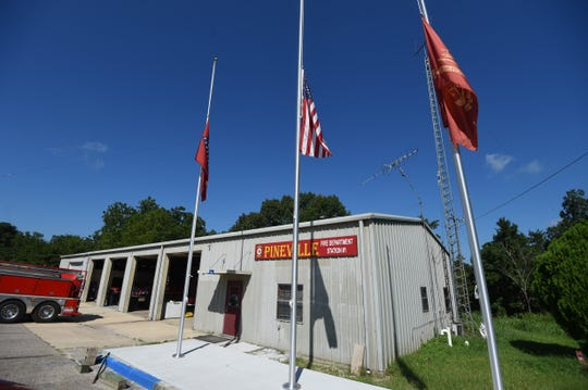 Flags fly at half staff Friday morning at the Pineville Volunteer Fire Department. Members of the department and the community mourned the loss of their chief, Mike Stephen, who was shot and killed in the line of duty while serving as a deputy with the Stone County Sheriff's Department.