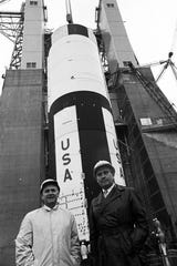Bernhard Tessmann and Wernher von Braun at the Saturn V rocket test stand at Marshall Space Flight Center in Huntsville, Alabama, in this file photo from the late 1960s.