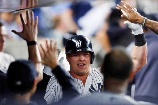 New York Yankees' Luke Voit is congratulated after hit solo home run during the fifth inning in the second game of the team's doubleheader against the Tampa Bay Rays, Thursday, July 18, 2019, in New York.