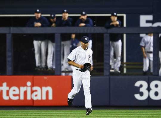 Mariano Rivera #42 of the New York Yankees enters the game to pitch for the final time at Yankee Stadium against the Tampa Bay Rays in the eighth inning during their game on September 26, 2013 at Yankee Stadium in New York.
