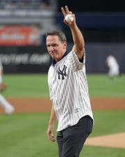 Jul 18, 2019; Bronx, NY, USA; New York Yankees former pitcher David Cone waves after throwing out the ceremonial first pitch on the twentieth anniversary of his perfect game before the second game of a doubleheader against the Tampa Bay Rays at Yankee Stadium.