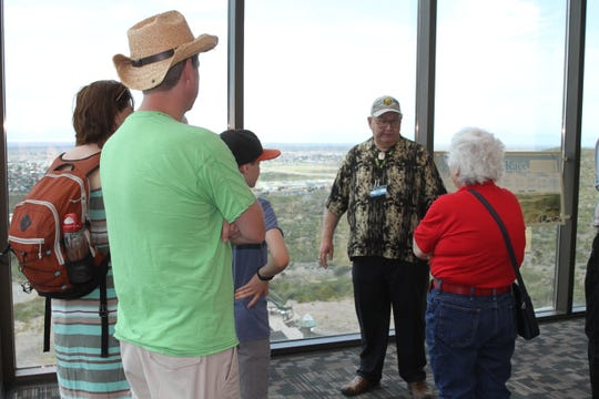 Dennis Clark, center, a volunteer at the New Mexico Museum of Space History shares the wonders of space with visitors July 17.