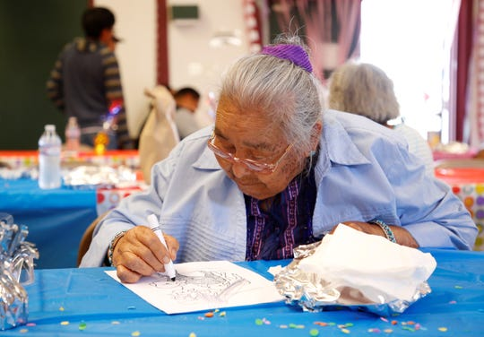 Pauline Walter focuses on her coloring activity during a luncheon organized by the Gadii'ahi Chapter Youth Council and the chapter's summer youth workers on July 18 at the Gadii'ahi-To'koi Chapter house.