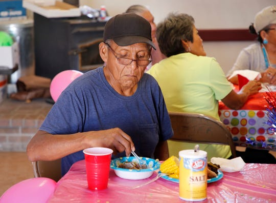 Ray Lee has a bowl of mutton vegetable stew during a luncheon organized by the Gadii'ahi Chapter Youth Council and the chapter's summer youth workers on July 18 at the Gadii'ahi-To'koi Chapter house.