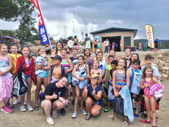 Governor Michelle Lujan-Grisham and the Ruidoso Boys and Girls Club after some fun on the Wibit Water Park at Grindstone Lake.