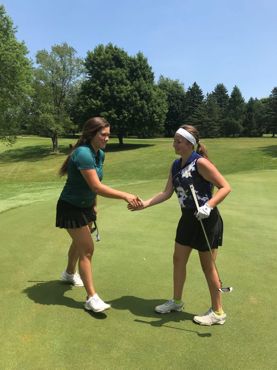 It took three playoff holes for Summer Horen (left) of White Lake and Ava Moore (right) of Highland to settle the score at Dunham Hills. Horen won by a single stroke.