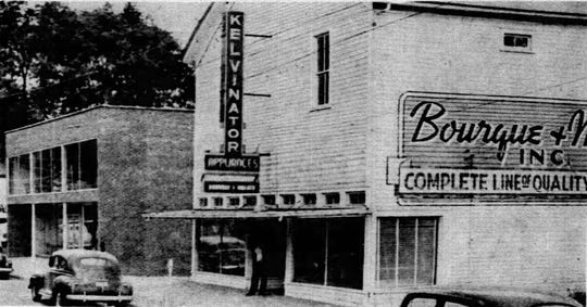 The old hotel building on West Landry Street where the Playshop (toy store) was located from 1953 until 1960, pictured here when it was Bourque and Walker Furniture in about 1952. The historic building was demolished in 1960 and today that site is a parking lot.