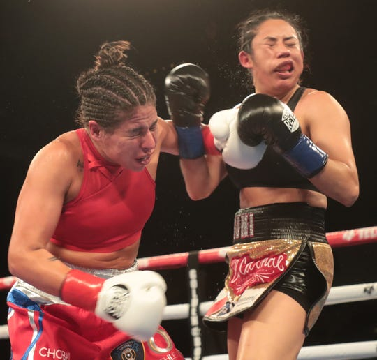 Marlen Esperaza, of Houston, Texas at left, lands on Sonia Osorio of Mexico City during their bout at Fantasy Springs Casino on July 18, 2019.