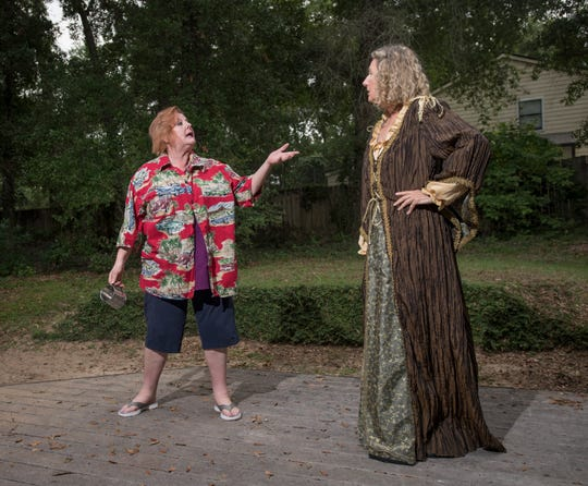 Kelly Shepherd (as Falstaff), left, and Connie Cali (as Mistress Quickly) perform as their Shakespeare company rehearses a scene from The Merry Wives of Windsor in Pensacola on Thursday, July 18, 2019.