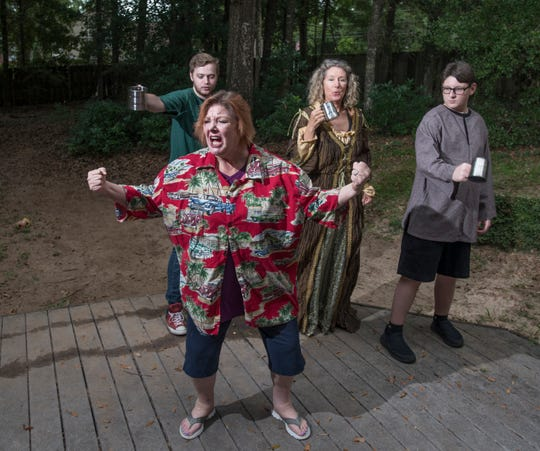 Kelly Shepherd (as Falstaff), clockwise from front, Gabriel Marsh (as Robert), Connie Cali (as Mistress Quickly), and Grey Wolfe (as John) perform as their Shakespeare company rehearses a scene from The Merry Wives of Windsor in Pensacola on Thursday, July 18, 2019.