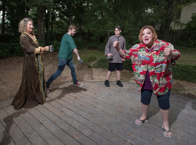 Connie Cali (as Mistress Quickly), from left, Gabriel Marsh (as Robert), Grey Wolfe (as John), and Kelly Shepherd (as Falstaff) perform as their Shakespeare company rehearses a scene from The Merry Wives of Windsor in Pensacola on Thursday, July 18, 2019.