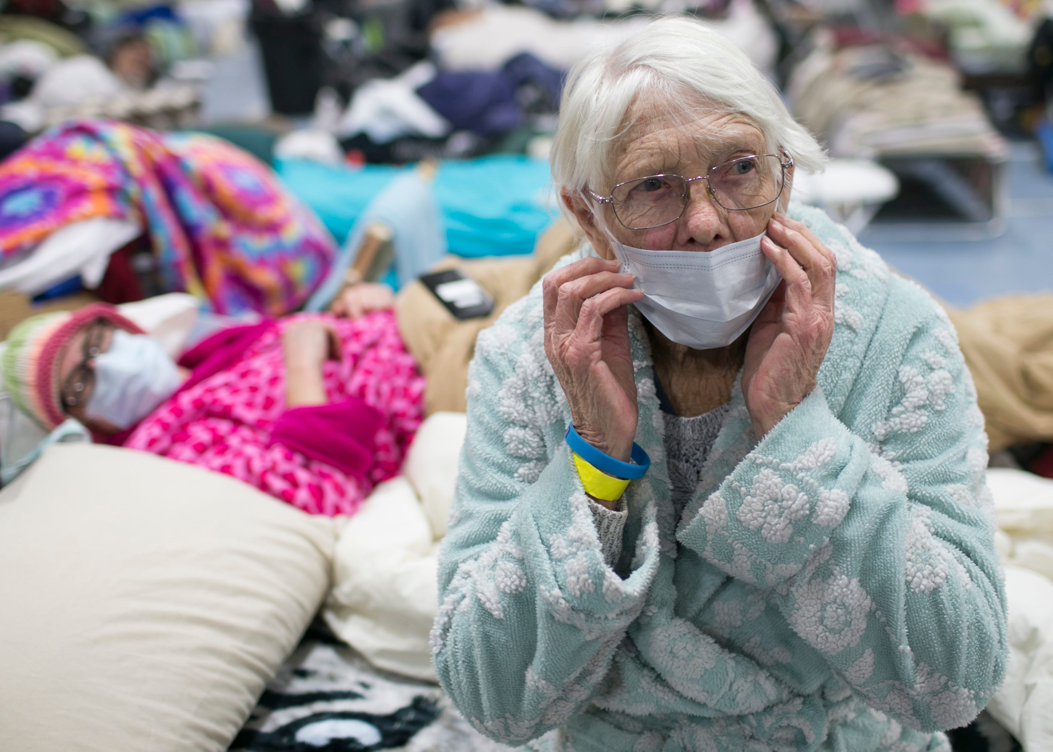 85-year-old Minna Andresen (right) sits for a portrait on a bed next to her daughter Libby Andresen (left) at the East Avenue Church Shelter in Chico, California on Thursday, November 15, 2018. The Andresens lost everything when the Camp Fire destroyed their property in Paradise.