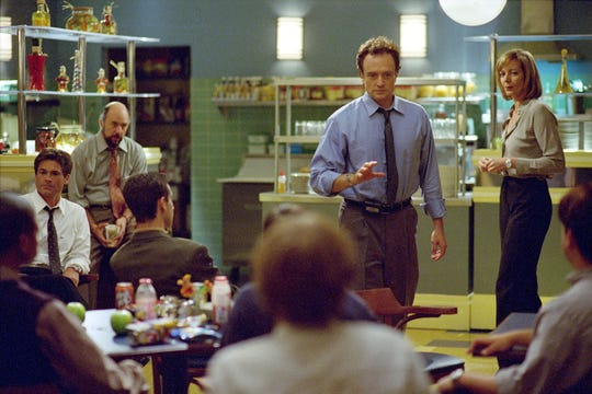 """Rob Lowe (from left), Richard Schiff, Bradley Whitford and Allison Janney star in an episode of """"The West Wing."""""""