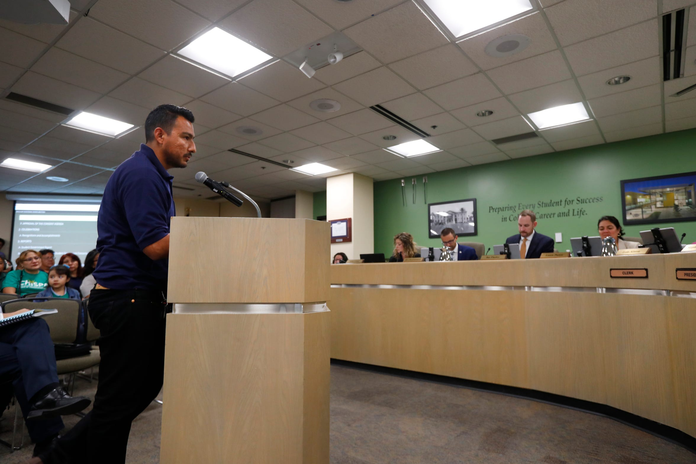 Julio Zuniga speaks in support of an electric school bus during a Phoenix Union High School District governing board meeting in Phoenix on April 11, 2019.