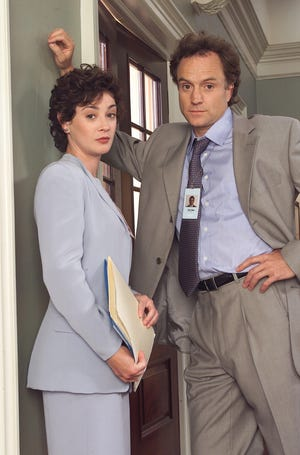 "Moira Kelly and Bradley Whitford star in ""The West Wing."""