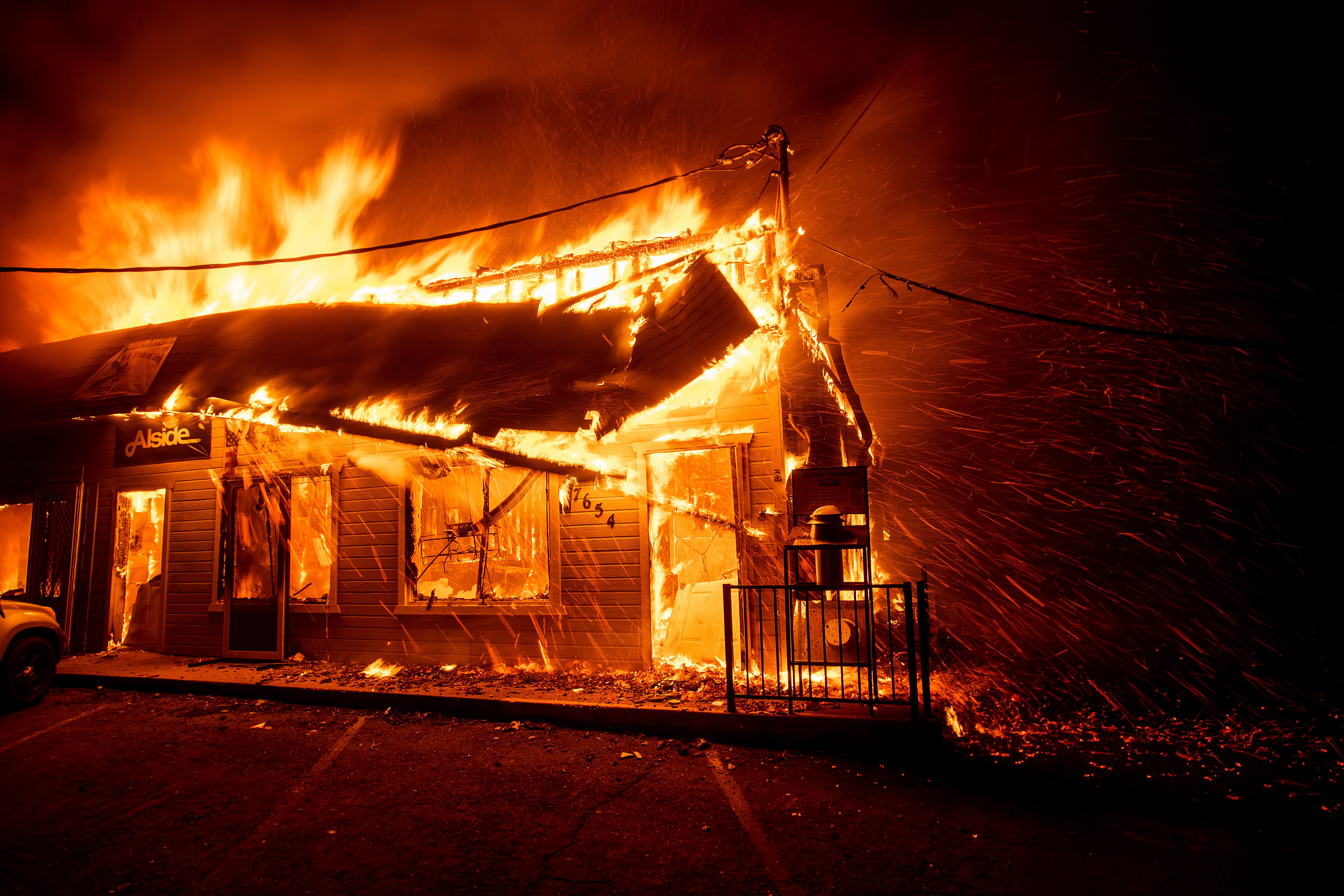 The Camp Fire consume the Screen & Window Shop as blaze tears through Paradise, California, on Nov. 8, 2018.