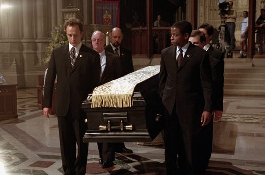 """Bradley Whitford (front left), Dule Hill (front right) and Richard Schiff (rear center) appear in a scene from """"The West Wing."""""""
