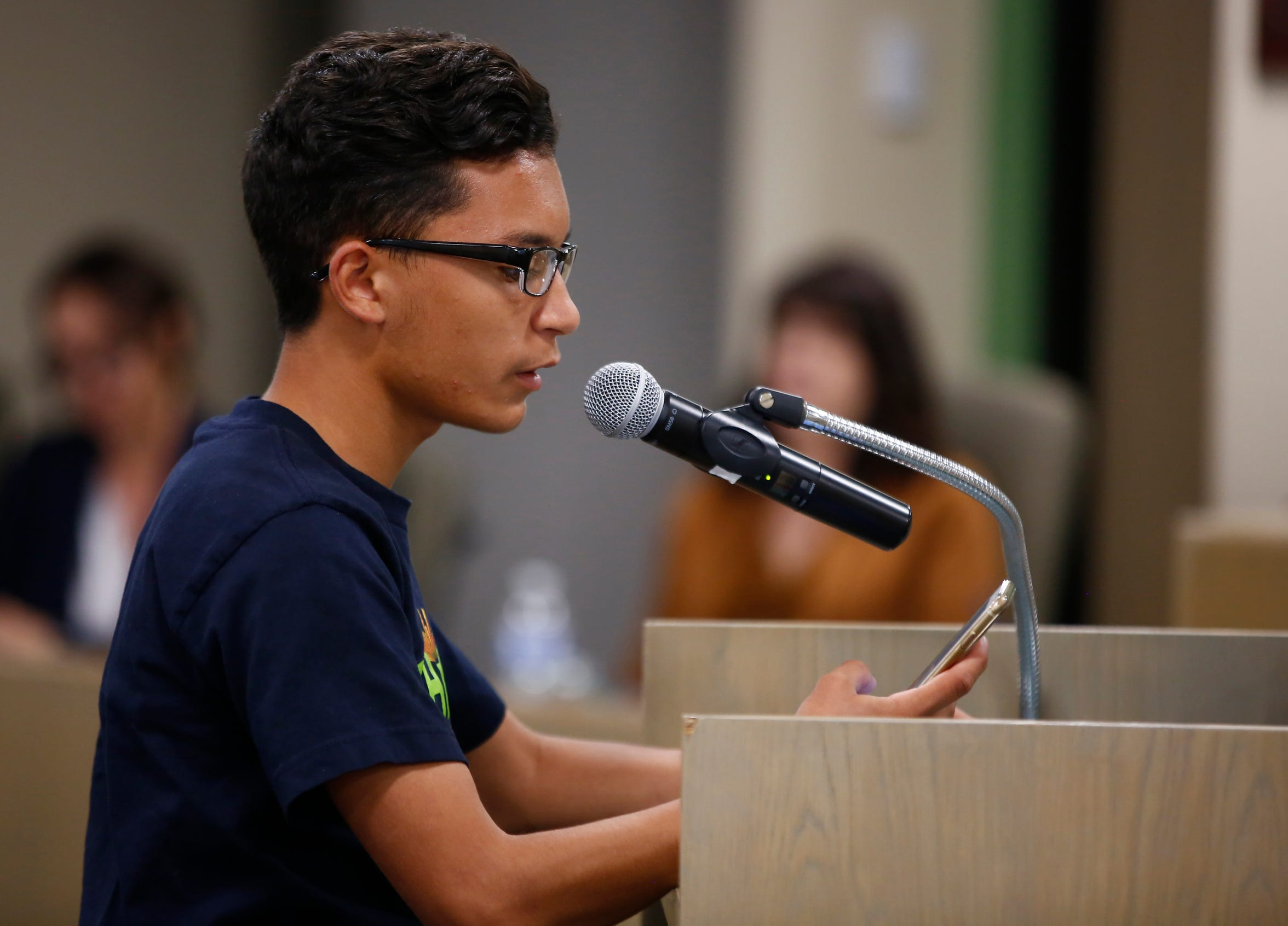 Levin Escarcega speaks in support of an electric school bus during a Phoenix Union High School District governing board meeting in Phoenix on April 11, 2019.
