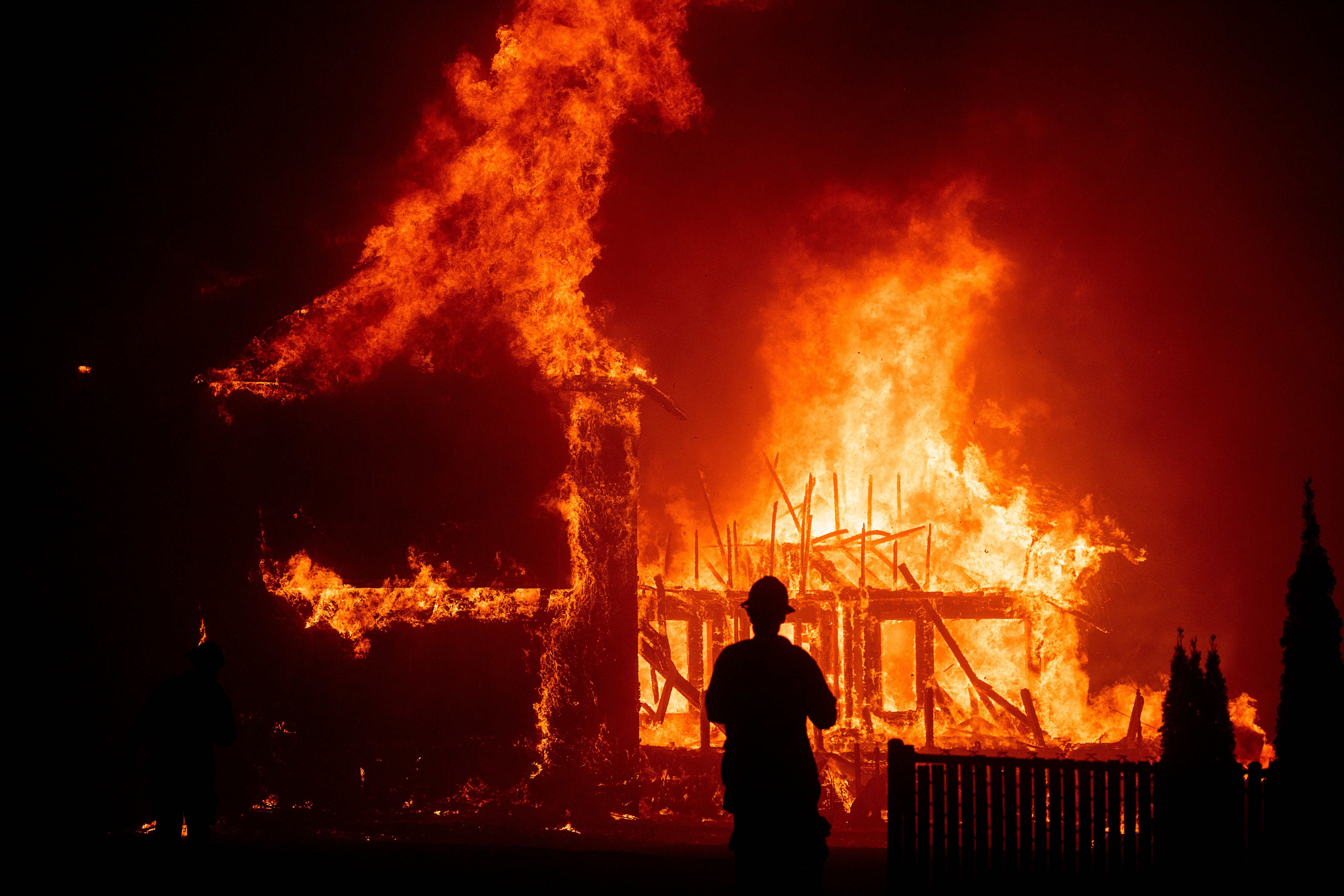 A home burns as the Camp Fire rages through Paradise, Calif., on Thursday, Nov. 8, 2018.