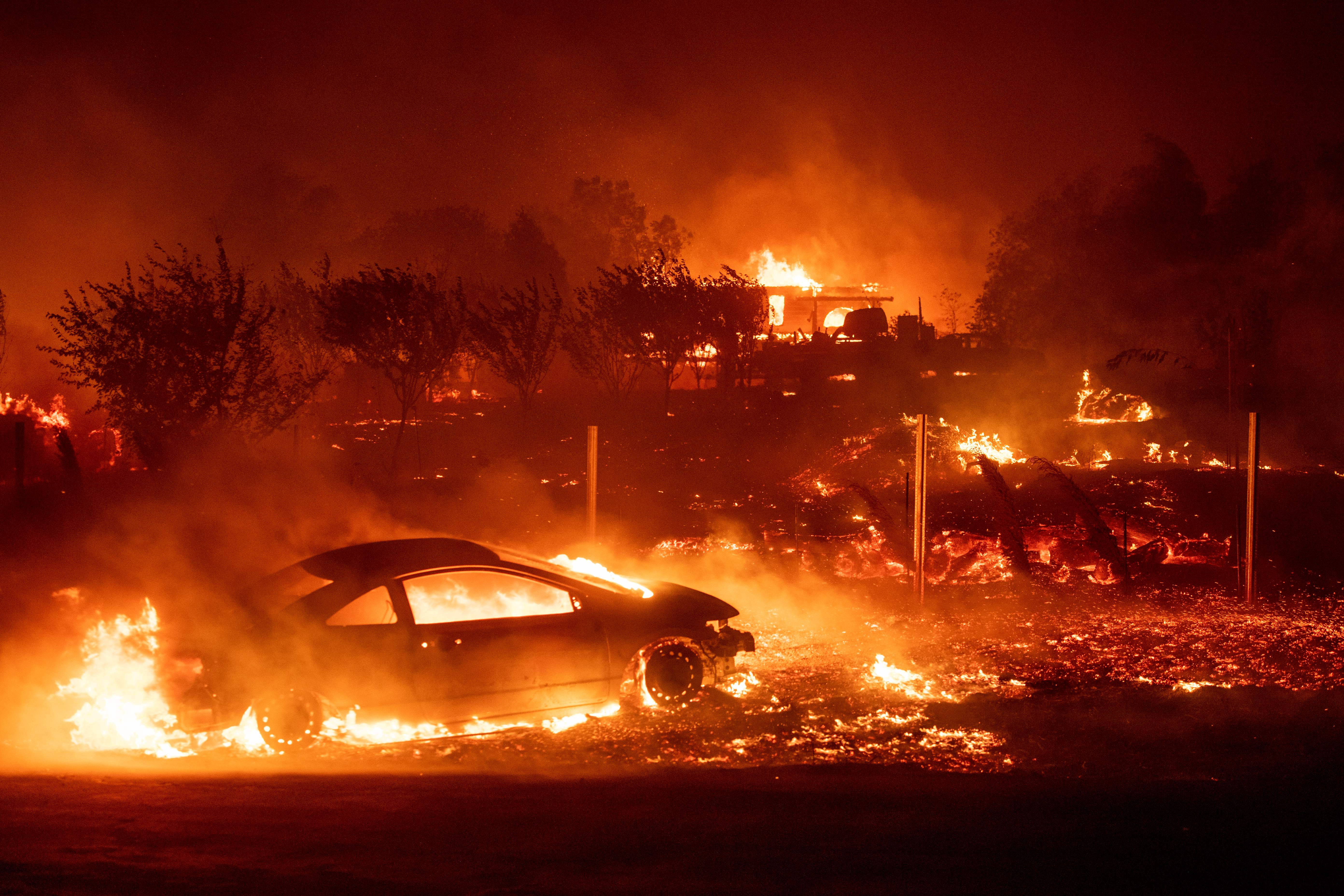 The Camp Fire consumes vehicles and homes as it rips through Paradise, California, on November 8, 2018.