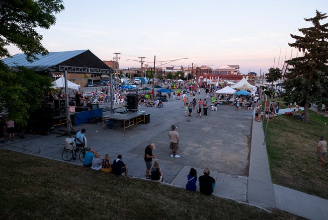 The sun begins to set over Port Huron on Family Night Thursday, July 18, 2019, during Blue Water Fest.
