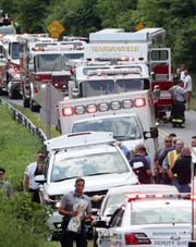 Rescue workers line Maloney Road in New Hackensack after a small plane crashed in the woods near the Dutchess County Airport on July 19, 2019.