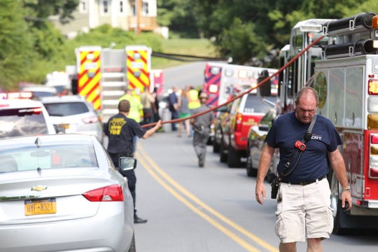 Responders search for a plane that crashed in a wooded area near Hudson Valley Regional Airport in Wappinger on Friday.