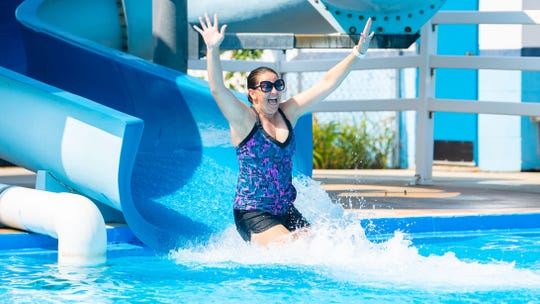 Teresa Armani is having a blast on the slide at the Lincolnway Swimming Pool and Sports Club in West Manchester Township.