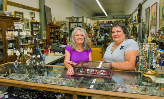Vickie Barnes, left, and Jan Le Crow recently opened their antique store on South Main Street.