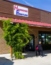 Customers enter Hammond Furniture and Flooring Center's new location between Raley's and Round Table Pizza.