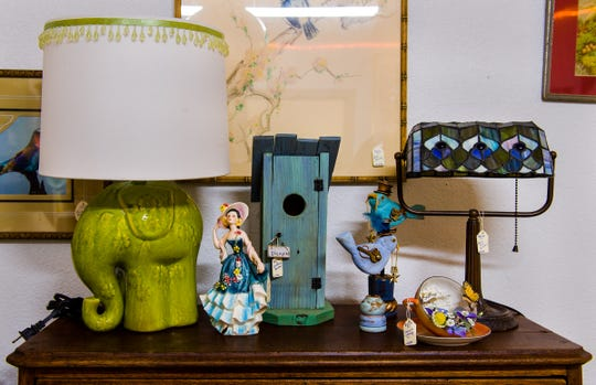 Vintage lamps and garden-style decor are available at the new antique store.