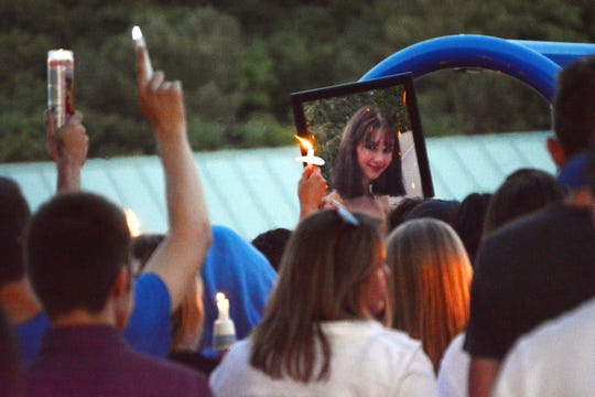 In this Monday, July 15, 2019 photo, family, friends and the community hold a vigil in Utica, N.Y., to remember 17-year-old Bianca Devins, of South Utica, who was killed by a man she'd met recently on Instagram, who then posted photos of her corpse online, police said Monday.