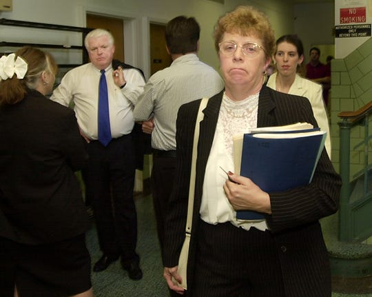 Patricia Brown leaves court in Buffalo as Pastor Fletcher Brothers talks with supporters in the background in 2002. A custody hearing had been held in the case of Sandra Brown, Patricia's 17-year-old daughter, who lives at Freedom Village, which Brothers runs. Patricia Brown later dropped the lawsuit.