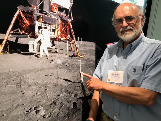 Robert Shanebrook, of Irondequoit, points to the lunar close-up camera he had a role in developing as an employee of Kodak Eastman Co. in 1969.