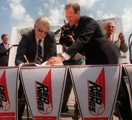 July 19, 1994: Robert E. Morgan representing the Corporation Sports Facility signs the lease on the new stadium as County Executive Bob King looks on Tuesday. Elliot Curwin, the president of Rochester Community Baseball, is in the background on right with pen in hand. He also signed the lease while on the stop at Oak and Platt streets, the site of the stadium.