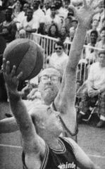 July 1991: Dick Vitale, foreground, tries to shoot over Jim Boeheim in a one-on-one.