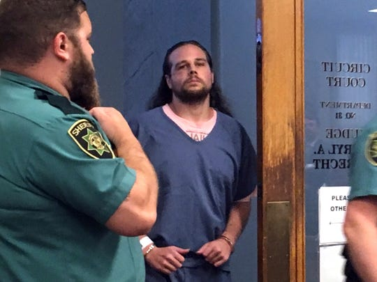 Jeremy Christian, accused of killing two passengers and wounding a third aboard a light-rail train in Portland, enters for a court appearance in Portland, Ore., July 18, 2017. Christian pleaded not guilty to aggravated murder, attempted murder and other charges.