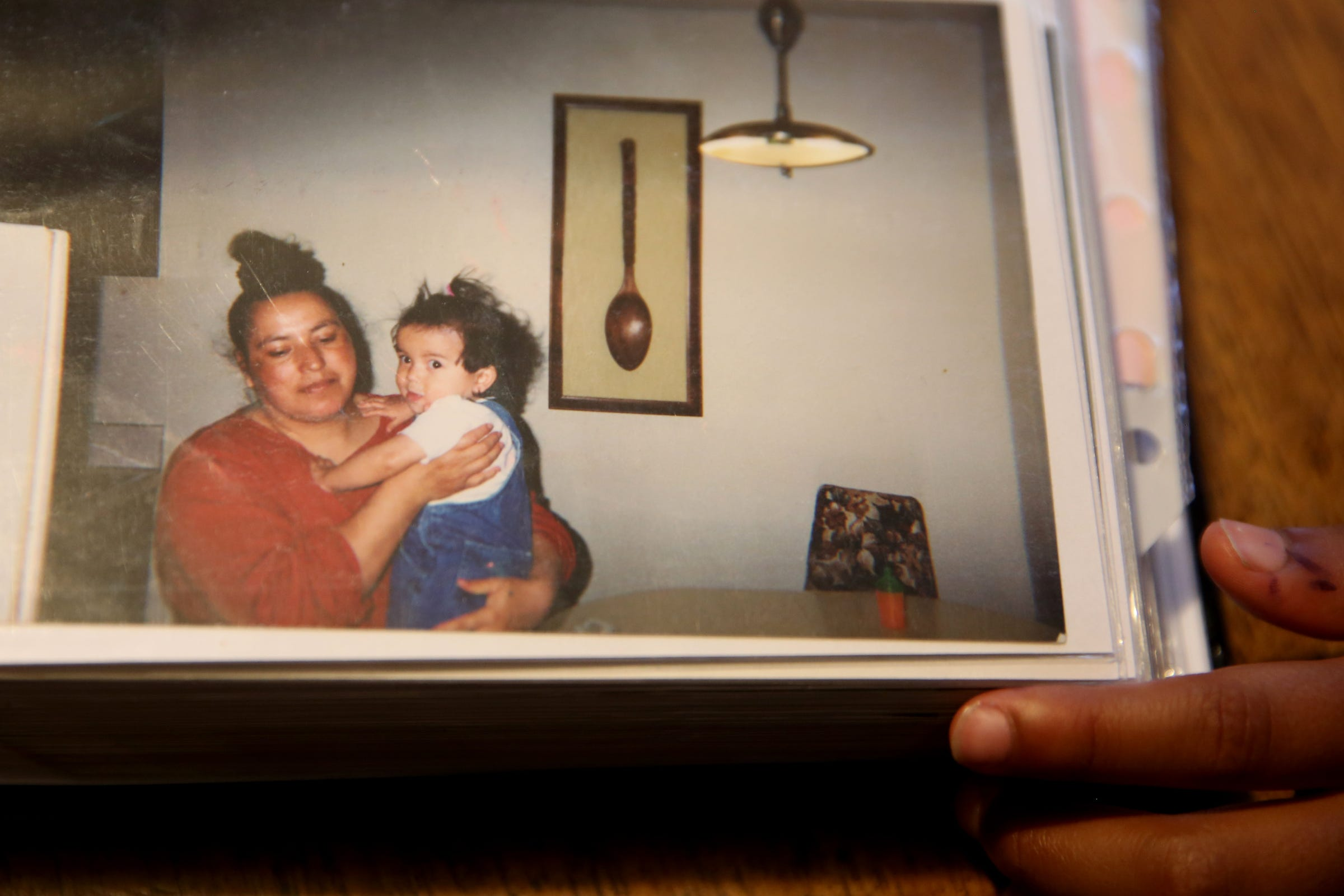 A photo of Erika Figueroa, now 18, being held by her mother, Maria, when she was young. Maria said all she wants for her children is to see their dreams come true.